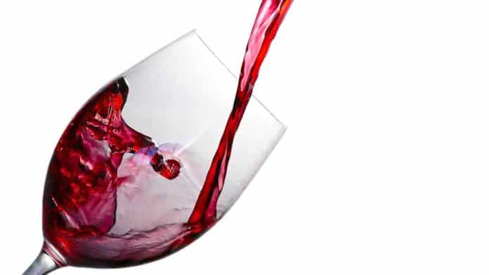 drink a glass of red wine before bed to sleep better at night